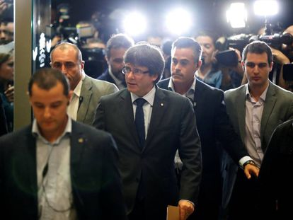 Catalan Regional Premier Carles Puigdemont arrives at a meeting with his PDeCat party.