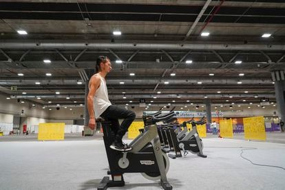 Pawel, a 32-year-old Pole, uses a stationary bike loaned to the shelter.