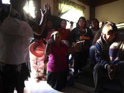 Edgar Tamayo's family prays in Miacatlán, Morelos state, Mexico.