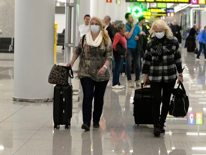 Tourists in Spain's Mallorca airport on March 16.