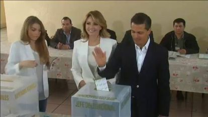 Video: President Peña Nieto casts his vote, as groups set fire to ballot stations in some states.