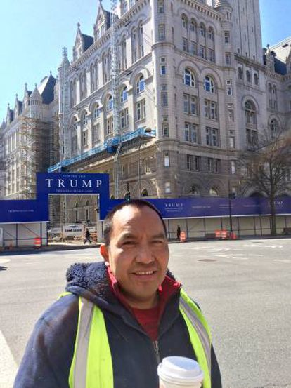 Construction worker Francisco Jiménez, with the hotel in the background.