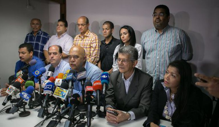 MUD secretary general Jesús Torrealba (center) during a news conference.