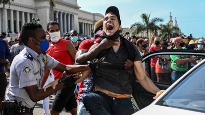 A man is arrested during protests in Havana on July 11.