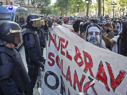 Demonstrators face up against riot police.
