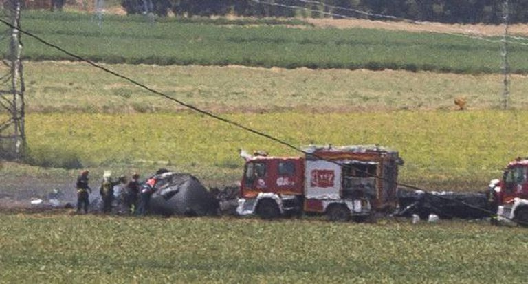 Firefighters at the scene of the Airbus A400M accident on May 9.