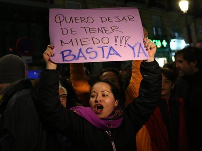 """A protestor with a sign reading: """"I wnat to stop being afraid! Enough is enough."""""""