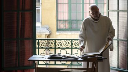 Carlos Tobes Arrabal examines the books containing the falsified baptism certificates.