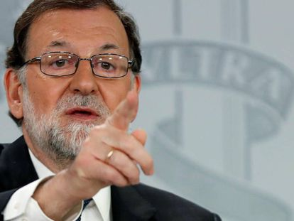Spanish Prime Minister Mariano Rajoy speaks to reporters on Friday.