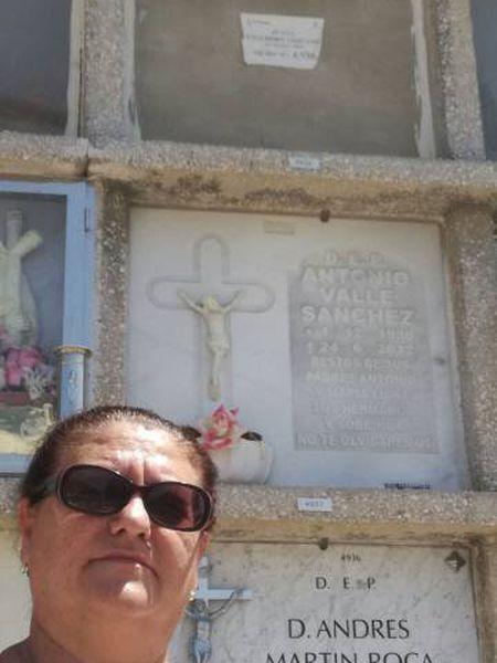 Juana Escudero Lezcano beside the tomb of her namesake.
