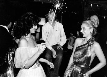 Prior to being a designer, Carolina was already a style icon. Here, she poses with Bianca Jagger at Studio 54 in 1979.