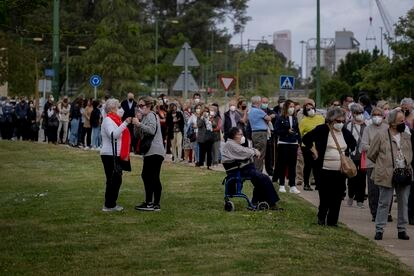 People wait in line to be vaccinated at a mass vaccination site in Seville.