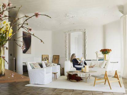 Ana Viladomiu in her living room in Gaudi's La Pedrera building in Barcelona.