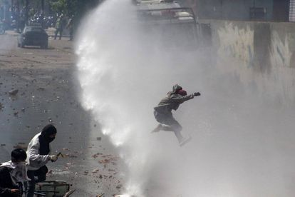 Riot police disperse protesters in April using water cannon.