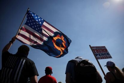 A supporter of President Donald Trump holds a flag with a reference to the QAnon conspiracy theory at a rally in September.
