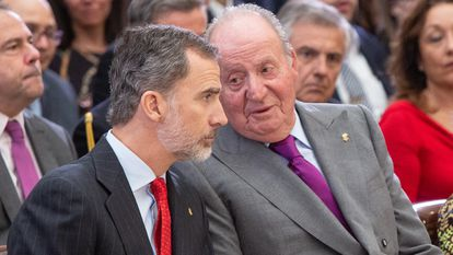 A file photo of King Felipe and his father, Juan Carlos.