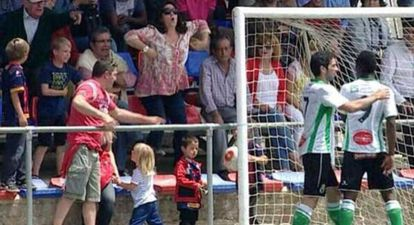 The fan is caught on camera making monkey-style gestures at Racing's Koné.