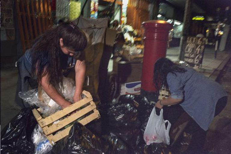 Trash-pickers search through garbage in Buenos Aires in 2008.