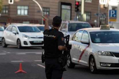 A police officer enforces the coronavirus restrictions on mobility in Madrid.