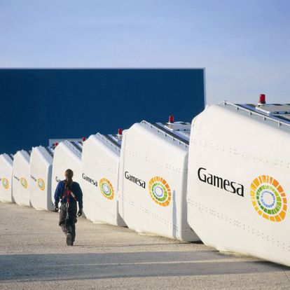 Wind turbine parts made by Gamesa, which has reduced the size of its management structure.