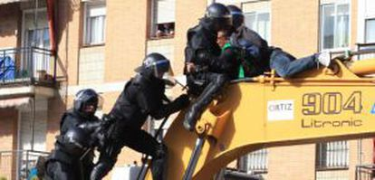 Police clash with residents trying to stop a home eviction in Madrid in February.