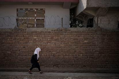 An Afghan girl walks to school in Kabul, Afghanistan on September 12.