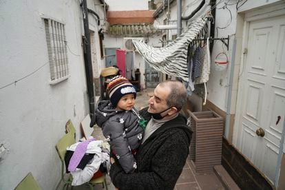 Jesús Rico, 49, with his grandson Saúl in one of the courtyards.