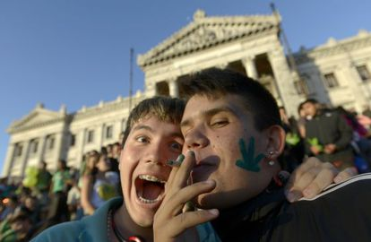 Activists share a joint in front of the Senate in Montevideo.