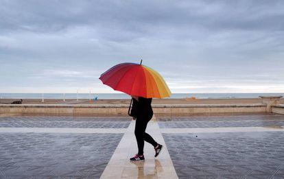 Rain falls in Malvarrosa beach in Valencia on Sunday.