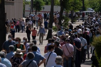 People wait in line to be vaccinated at the Estadio Olímpico in Seville on May 20.