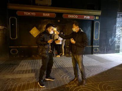 Chungki Ji does a temperature check outside his bar Tokyo Bar Disco Pub in Madrid.