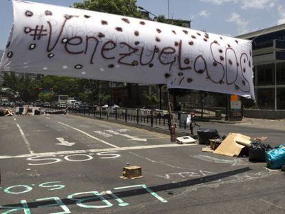 A roadblock is set up in front of the United Nations office in Caracas.
