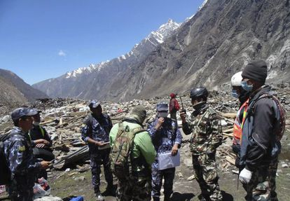 Nepalese soldiers inspect the damage caused by the quake in Langtang Valley.