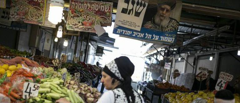 A photo of Rabbi Ovadia Yosef, founder of the ultra-orthodox Sephardic party Shas at a market in Tel Aviv.