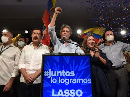 Guillermo Lasso celebrates his win in the Ecuadorian presidential elections on Sunday in Quito.