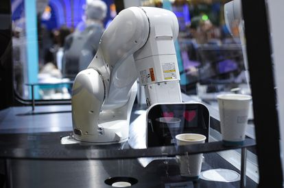 A robot serves a coffee at the 2019 Mobile World Congress in Barcelona.