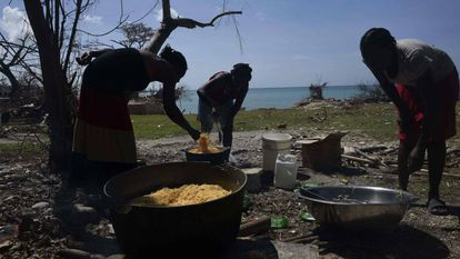 A group of women preparing food in the aftermath of Hurricane Matthew in Haiti.