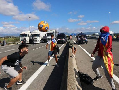 An impromptu soccer game on the C-25 road near Gurb, Catalonia on Tuesday.