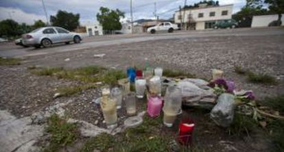 Candles in memory of the victims killed during clashes in Iguala.