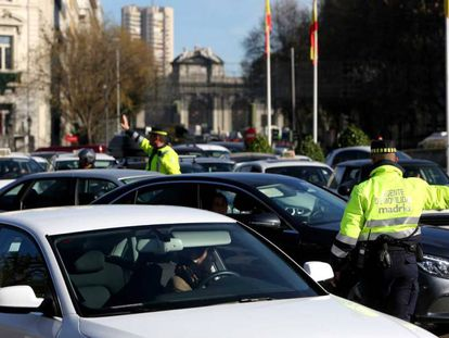 Traffic police direct vehicles in central Madrid.