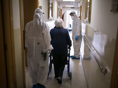 Volunteers from Proactiva Open Arms help residents at a nursing home in Barcelona.