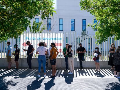 People wait in line to be vaccinated outside Isabel Zendal Hospital in Madrid.