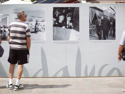 Visitors inspect an open-air tourism exhibition in Torremolinos.