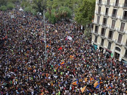 People throng the streets of Barcelona during Tuesday's general strike.