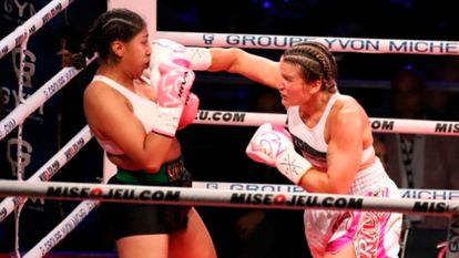 Jeanette Zacarías (left) being punched by Marie-Pier Houle during their fight in Montreal, Canada.