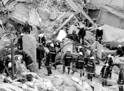 Firefighters look for survivors after the 1994 AMIA car bombing.