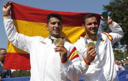 Saúl Craviotto and Cristian Toro celebrate their win.