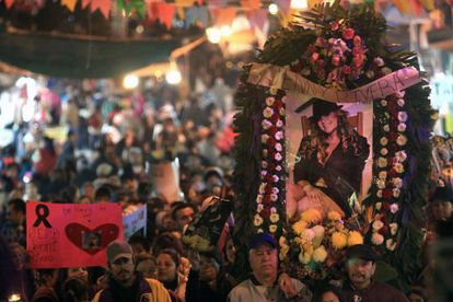 Fans of Mexican-US singer Jenni Rivera follow a memorial procession  in Monterry, Mexico