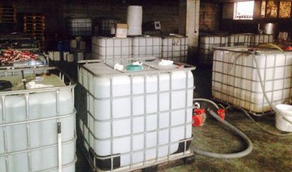 Plastic vats filled with alcohol in en Maside (Ourense)