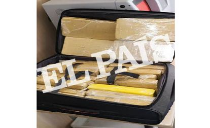 The suitcase containing bundles of cocaine that were not concealed.